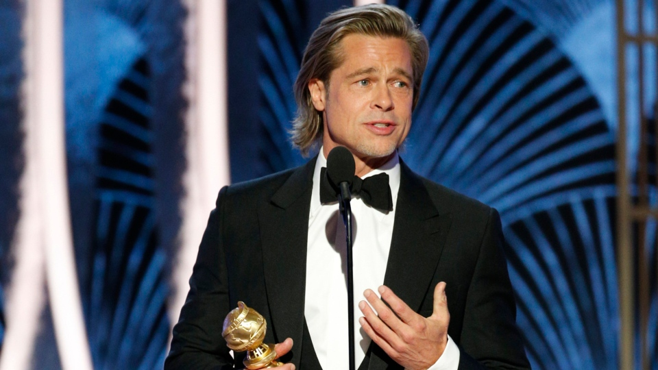 "This image released by NBC shows Brad Pitt accepting the award for best supporting actor in a film for his role in ""Once Upon A Time...In Hollywood"" at the 77th Annual Golden Globe Awards at the Beverly Hilton Hotel in Beverly Hills, Calif., on Sunday, Jan. 5, 2020. (Paul Drinkwater/NBC via AP)"