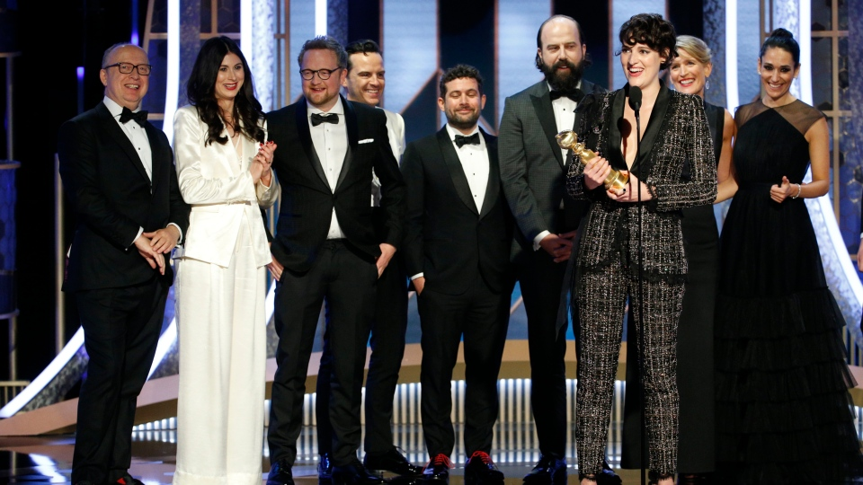 "This image released by NBC shows Phoebe Waller-Bridge accepting the award for best TV comedy series for ""Fleabag"" as fellow cast and crew members look on at the 77th Annual Golden Globe Awards at the Beverly Hilton Hotel in Beverly Hills, Calif., on Sunday, Jan. 5, 2020. (Paul Drinkwater/NBC via AP)"
