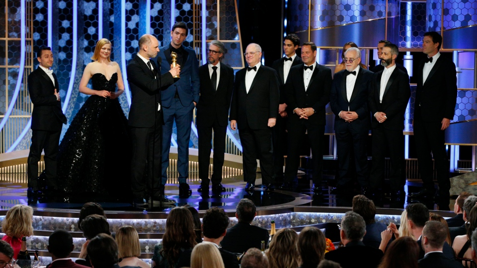 "This image released by NBC shows Jesse Armstrong, third from left, and cast members accepting the award for best drama TV series for ""Succession"" at the 77th Annual Golden Globe Awards at the Beverly Hilton Hotel in Beverly Hills, Calif., on Sunday, Jan. 5, 2020. (Paul Drinkwater/NBC via AP)"