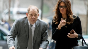 Harvey Weinstein, left, arrives at court with his lead attorney Donna Rotunno after a lunch break on the first day of jury selection of his sexual assault trial, Tuesday, Jan. 7, 2020, in New York. (AP Photo/Mary Altaffer)
