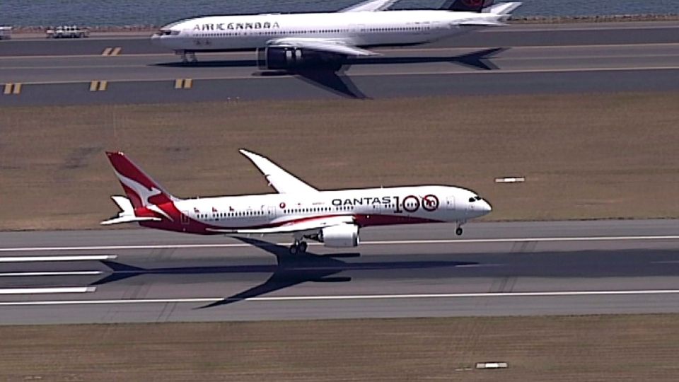 In this image made from video, Qantas Boeing 787 Dreamliner plane lands at Sydney airport in Sydney, Friday, Nov. 15, 2019. (Australia Pool via AP)