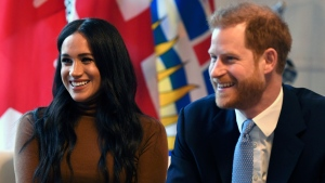 Britain's Prince Harry and Meghan, Duchess of Sussex smile during their visit to Canada House in thanks for the warm Canadian hospitality and support they received during their recent stay in Canada, in London, Tuesday, Jan. 7, 2020. (Daniel Leal-Olivas/Pool Photo via AP)