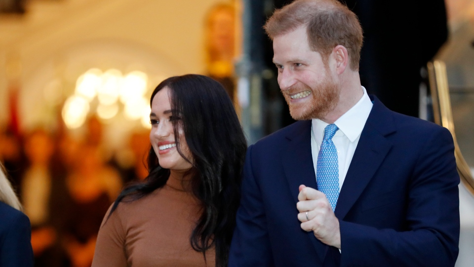 In this Tuesday Jan. 7, 2020 file photo Britain's Prince Harry and Meghan, Duchess of Sussex leave after visiting Canada House in London after their recent stay in Canada. (AP Photo/Frank Augstein, FILE)
