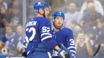 Toronto Maple Leafs defenceman Rasmus Sandin (38) confers with defenceman Martin Marincin (52) during third period NHL pre-season hockey action against the Buffalo Sabres in Toronto on Friday, September 20, 2019. THE CANADIAN PRESS/Chris Young
