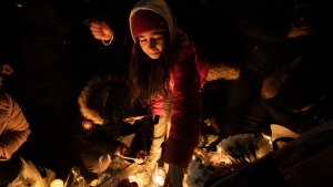 Mourners attend a vigil in Toronto on Thursday January 9, 2020, to remember the victims of the Iranian air crash. THE CANADIAN PRESS/Chris Young