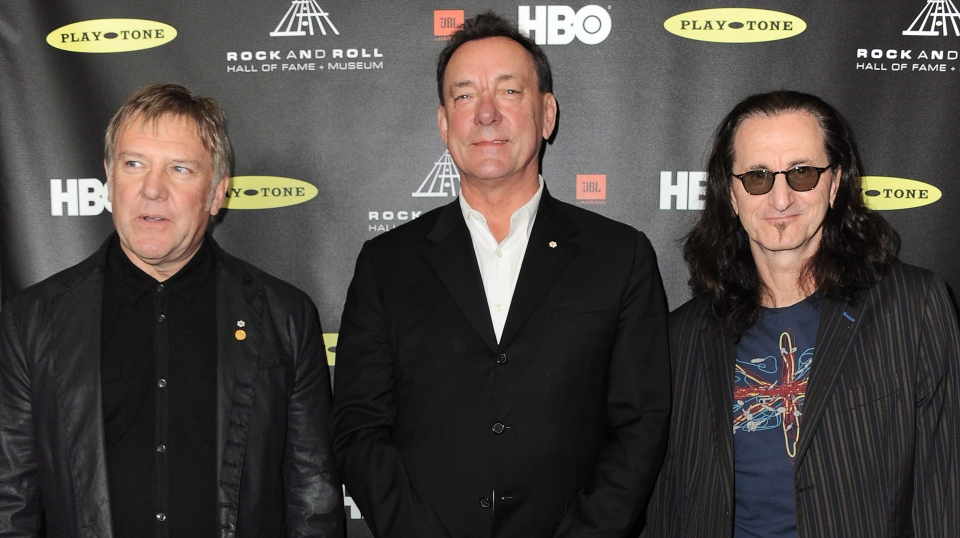 From left, Alex Lifeson, Neil Peart, and Geddy Lee of Rush attend the Rock and Roll Hall of Fame Induction Ceremony at the Nokia Theatre on Thursday, April 18, 2013 in Los Angeles. (Photo by Jordan Strauss/Invision)