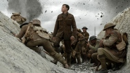 """This image released by Universal Pictures shows George MacKay, center, in a scene from """"1917,"""" directed by Sam Mendes. (François Duhamel/Universal Pictures via AP)"""