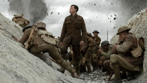 "This image released by Universal Pictures shows George MacKay, center, in a scene from ""1917,"" directed by Sam Mendes. (François Duhamel/Universal Pictures via AP)"