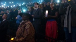 People observe a moment of silence during an event to commemorate the ten year anniversary of the Haiti quake, in Montreal, Sunday, Jan. 12, 2020. THE CANADIAN PRESS/Graham Hughes