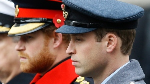 William, right, Prince Harry, left, attend the Remembrance Sunday ceremony at the Cenotaph in London. Britain's Queen Elizabeth II is set to hold face-to-face talks Monday, Jan. 13, 2020 with Prince Harry for the first time since he and his wife, Meghan, unveiled their controversial plan to walk away from royal roles — at a dramatic family summit meant to chart a future course for the couple. The meeting at the monarch's private Sandringham estate in eastern England will also include Harry's father Prince Charles and his brother Prince William.  (AP Photo/Kirsty Wigglesworth, File)