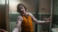 """This image released by Warner Bros. Pictures shows Joaquin Phoenix in a scene from """"Joker."""" On Monday, Jan. 13, the film was nominated for an Oscar for best picture. (Niko Tavernise/Warner Bros. Pictures via AP)"""