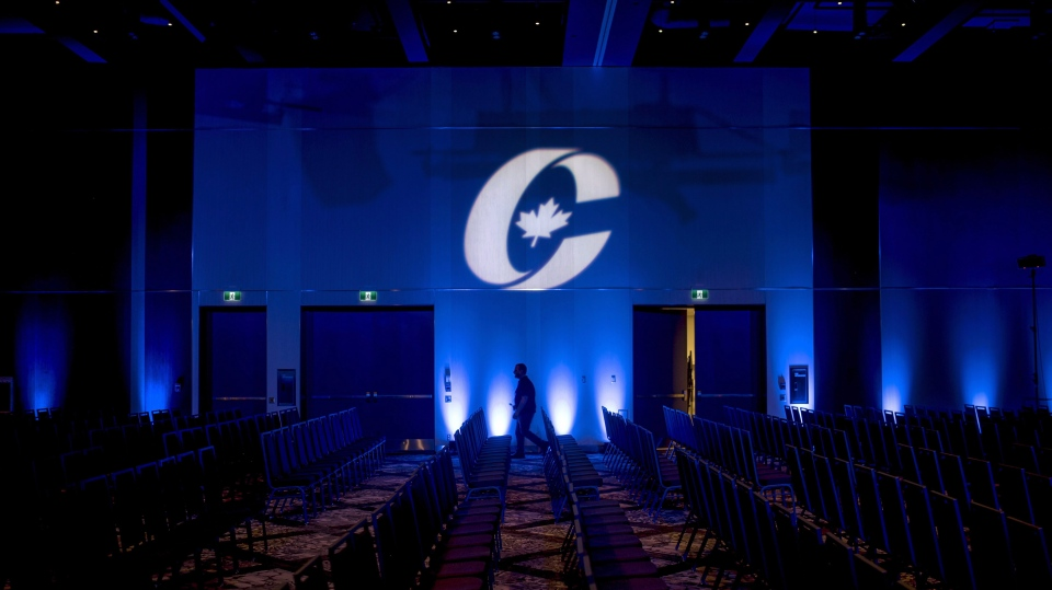 The race for leadership of the federal Conservatives begins officially on Monday. A man is silhouetted walking past a Conservative Party logo before the opening of the Party's national convention in Halifax, Thursday, Aug. 23, 2018. THE CANADIAN PRESS/Darren Calabrese