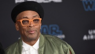 """In this Dec. 16, 2019 file photo, Spike Lee arrives at the world premiere of """"Star Wars: The Rise of Skywalker"""" in Los Angeles. Spike Lee will lead the jury of this year's Cannes Film Festival, and festival organizers hope the provocative American director will """"shake things up"""" at the gathering of the world's cinema elite.(Jordan Strauss/Invision/AP, File )"""