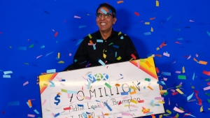 Adlin Lewis is seen in this photo collecting his $70 million cheque on Jan. 13, 2020.  (PHOTO: Ontario Lottery and Gaming Corporation)