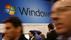 In this Jan. 11, 2010 file photo, a display for Microsoft's Windows 7 is shown at the National Retail Federation's convention in New York. (AP Photo/Mark Lennihan, File)