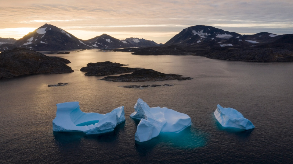 In this Aug. 16, 2019, file photo, large icebergs float away as the sun rises near Kulusuk, Greenland. The decade that just ended was by far the hottest ever measured on Earth, capped off by the second-warmest year on record, NASA and the National Oceanic and Atmospheric Administration reported Wednesday, Jan. 15, 2020. (AP Photo/Felipe Dana, File)