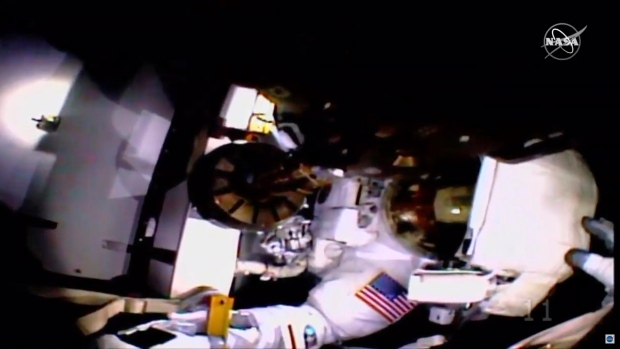 Astronaut completes space walk without helmet camera, lights