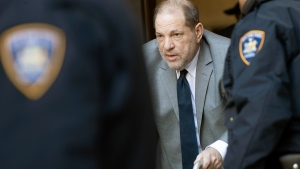 Harvey Weinstein, center, is escorted by court officers as he leaves court for the day during jury selection in his trial on rape and sexual assault charges, Wednesday, Jan. 15, 2020, in New York. Jury selection continues Thursday. (AP Photo/Mary Altaffer)