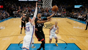 Toronto Raptors guard Norman Powell (24) shoots as Oklahoma City Thunder forward Mike Muscala (33) defends during the first half of an NBA basketball game Wednesday, Jan. 15, 2020, in Oklahoma City. (AP Photo/Sue Ogrocki)