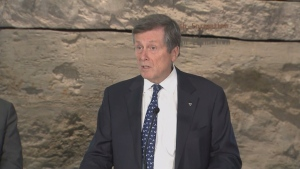 Mayor John Tory speaks with reporters at Evergreen Brick Works on Thursday.