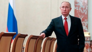 Russian President Vladimir Putin stands prior to a cabinet meeting in Moscow, Russia, Wednesday, Jan. 15, 2020. (Dmitry Astakhov, Sputnik, Government Pool Photo via AP)