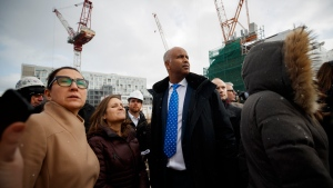 Ahmed Hussen, Canada's Minister of Families, Children and Social Development looks on with Deputy Prime Minister Chrystia Freeland during a tour of a construction site that will soon house residential housing in Toronto, Thursday, Jan. 16, 2020. THE CANADIAN PRESS/Cole Burston