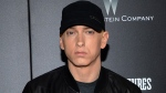 "FILE - In this July 20, 2015, file photo, rapper Eminem attends the premiere of ""Southpaw"" in New York. Rapper Eminem once again dropped a surprise album, releasing ""Music to be Murdered By"" on Friday, Jan. 17, 2020. (Photo by Evan Agostini/Invision/AP, File)"