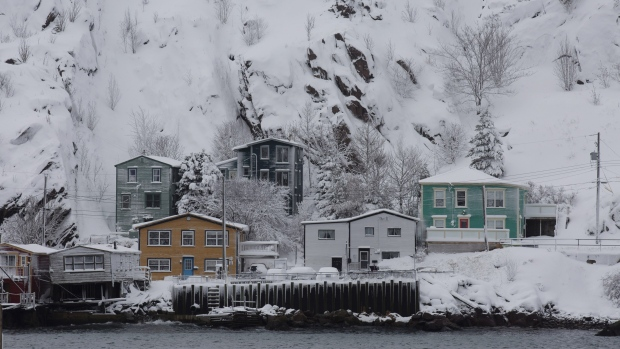 Resident wakes to wall of snow after storm lashes eastern Canada