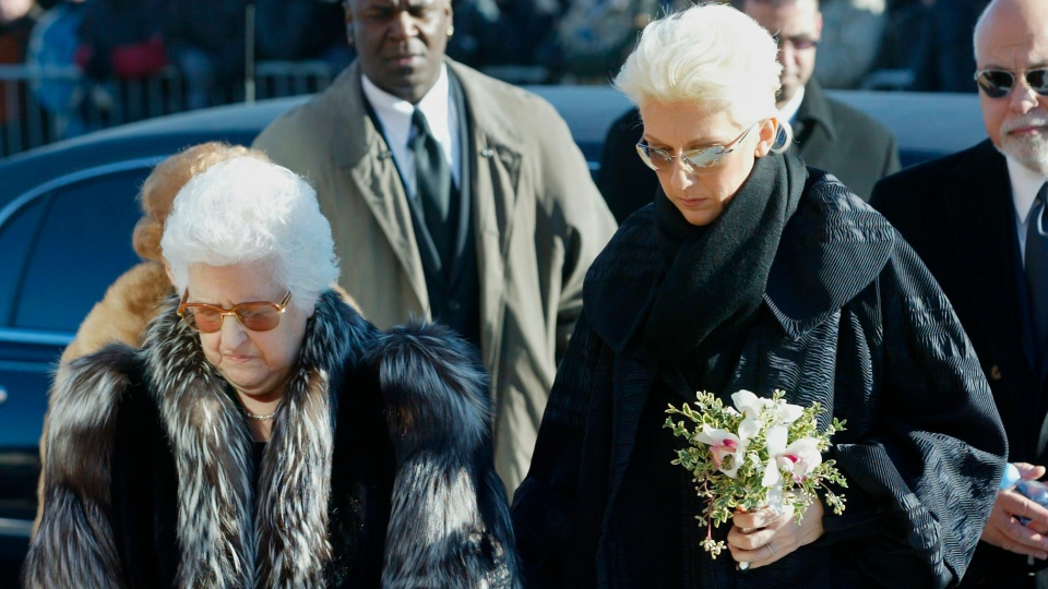 Singer Celine Dion accompanies her mother Therese as they arrive for funeral services for her father Adhemar Dion as her husband Rene Angelil (right) follows on Thursday, Dec 4, 2003 in Charlemagne, Quebec. THE CANADIAN PRESS/Paul Chiasson