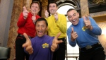 In this June 28, 2006 file photo, Australian children's entertainers The Wiggles, Murray Cook (Red Wiggle), Greg Page (Yellow Wiggle), Jeff Fatt (Purple Wiggle), and Anthony Field (Blue Wiggle) make a special appearance at the Australian High Commission in London at the start of their UK tour. (AP Photo/Christopher Pledger, File)