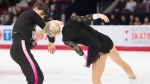 Piper Gilles's hair gets caught into the costume of Paul Poirier during the senior ice dance rhythm at the 2020 Canadian Tire National Skating Championships in Mississauga, Ont., on Friday, January 17, 2020. THE CANADIAN PRESS/Nathan Denette