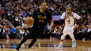 Toronto Raptors guard Norman Powell (24) drives to the net with Washington Wizards guard Gary Payton II (20) trailing during first half of their NBA basketball game in Toronto, Friday, Jan. 17, 2020. THE CANADIAN PRESS/Cole Burston