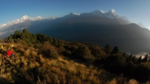 FILE - In this Oct. 24, 2014, file photo, trekkers watch the sun rise over the Annapurna Range, right, in central Nepal, as viewed from Poon Hill, above the village of Ghorepani. An avalanche swept the popular Annapurna circuit trekking route, which encircles Mount Annapurna, leaving at least four South Koreans and three Nepali guides missing, authorities said Saturday, Jan. 18, 2020. (AP Photo/Malcolm Foster, File)