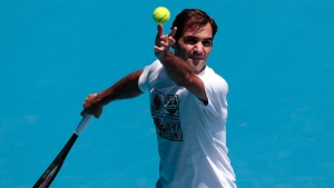 Switzerland's Roger Federer serves during a practice session ahead of the Australian Open tennis championship in Melbourne, Australia, Saturday, Jan. 18, 2020. (AP Photo/Dita Alangkara)