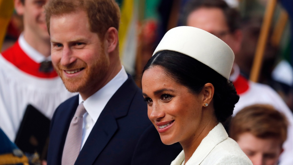 FILE - In this Monday, March 11, 2019 file photo, Britain's Prince Harry and Meghan, the Duchess of Sussex leave after the Commonwealth Service at Westminster Abbey in London. Prince Harry and Meghan Markle are to no longer use their HRH titles and will repay £2.4 million of taxpayer's money spent on renovating their Berkshire home, Buckingham Palace announced Saturday, Jan. 18. 2020. (AP Photo/Frank Augstein, file)
