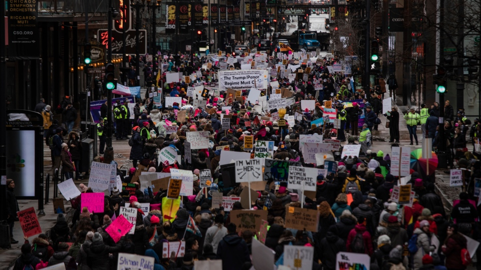 Thousands of people take to the streets for the Women's March in downtown Chicago on Saturday, Jan. 18, 2020. Thousands gathered in cities across the country Saturday as part of the nationwide Women's March rallies focused on issues such as climate change, pay equity, reproductive rights and immigration. (Ralf Nabong/Chicago Sun-Times via AP)