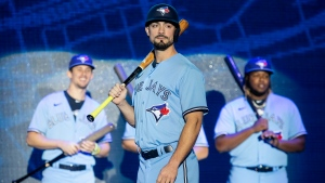 Toronto Blue Jays' Randal Grichuk stands to the fore as teammates Cavan Biggio (left) and Vladimir Guerrero Jr. look on as the team launch their new blue uniforms during their Winter Fest celebration in Toronto on Saturday January 18, 2020. THE CANADIAN PRESS/Chris Young