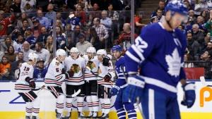 Chicago Blackhawks centre Drake Caggiula (91) celebrates his goal with teammates during first period NHL hockey action against the Toronto Maple Leafs, in Toronto, Saturday, Jan. 18, 2020. THE CANADIAN PRESS/Cole Burston
