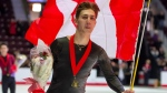 Roman Sadovsky does a victory lap with his medal after winning the Men's competition at the 2020 Canadian Tire National Skating Championships in Mississauga, Ont., on Saturday, Jan. 18, 2020. THE CANADIAN PRESS/Frank Gunn