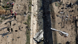 In this Wednesday, Jan. 8, 2020 photo, rescue workers search the scene where a Ukrainian plane crashed in Shahedshahr, southwest of the capital Tehran, Iran. Canadian investigators are getting their first chance to visit the crash site outside of Tehran today, as part of an international team looking into the sequence of events that ended with a jet from Ukraine being shot out of the sky. THE CANADIAN PRESS/AP-Ebrahim Noroozi