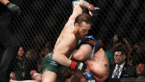 "Conor McGregor, left, fights Donald ""Cowboy"" Cerrone during a UFC 246 welterweight mixed martial arts bout Saturday, Jan. 18, 2020, in Las Vegas. (AP Photo/John Locher)"