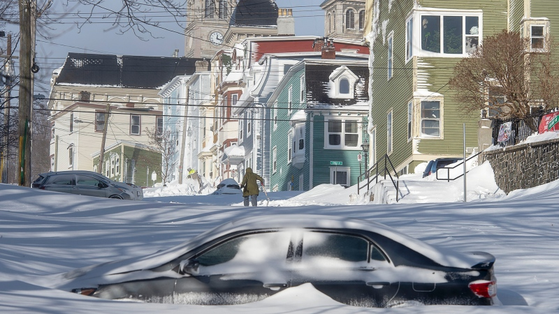 A half buried car is parked in St. John's on Saturday, January 18, 2020. The state of emergency ordered by the City of St. John's is still in place, leaving businesses closed and vehicles off the roads in the aftermath of the major winter storm that hit the Newfoundland and Labrador capital. THE CANADIAN PRESS/Andrew Vaughan