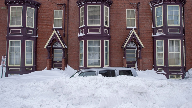 A vehicle is burried in snow in St. John's on Sunday, Jan. 19, 2020. The state of emergency ordered by the City of St. John's continues, leaving most businesses closed and vehicles off the roads in the aftermath of the major winter storm that hit the Newfoundland and Labrador capital. THE CANADIAN PRESS/Andrew Vaughan