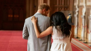 FILE - In this Wednesday May 8, 2019 file photo Britain's Prince Harry and Meghan, Duchess of Sussex, leave after a photo call with their newborn son, in St George's Hall at Windsor Castle, Windsor, south England. (Dominic Lipinski/Pool via AP, File)