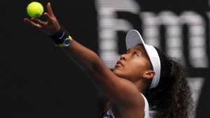 Japan's Naomi Osaka serves to Marie Bouzkova of the Czech Republic during their first round singles match the Australian Open tennis championship in Melbourne, Australia, Monday, Jan. 20, 2020. (AP Photo/Lee Jin-man)
