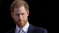FILE - In this Thursday, Jan. 16, 2020, file photo, Britain's Prince Harry arrives in the gardens of Buckingham Palace in London. (AP Photo/Kirsty Wigglesworth, File)