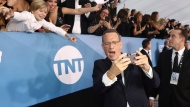 Tom Hanks arrives at the 26th annual Screen Actors Guild Awards at the Shrine Auditorium & Expo Hall on Sunday, Jan. 19, 2020, in Los Angeles. (Photo by Matt Sayles/Invision/AP)