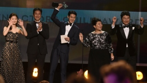 "Park So-dam, from left, Lee Sun Gyun, Choi Woo-shik, Lee Jeong-eun and Kang-Ho Song accept the award for outstanding performance by a cast in a motion picture for ""Parasite"" at the 26th annual Screen Actors Guild Awards at the Shrine Auditorium & Expo Hall on Sunday, Jan. 19, 2020, in Los Angeles. (AP Photo/Chris Pizzello)"