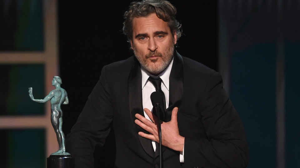 "Joaquin Phoenix accepts the award for outstanding performance by a male actor in a leading role for ""Joker"" at the 26th annual Screen Actors Guild Awards at the Shrine Auditorium & Expo Hall on Sunday, Jan. 19, 2020, in Los Angeles. (Photo/Chris Pizzello)"