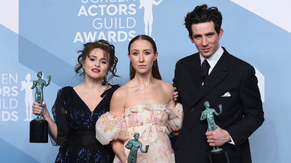 "Helena Bonham Carter, from left, Erin Doherty, and Josh O'Connor pose in the press room with the award for outstanding performance by an ensemble in a drama series for ""The Crown"" at the 26th annual Screen Actors Guild Awards at the Shrine Auditorium & Expo Hall on Sunday, Jan. 19, 2020, in Los Angeles. (Photo by Jordan Strauss/Invision/AP)"